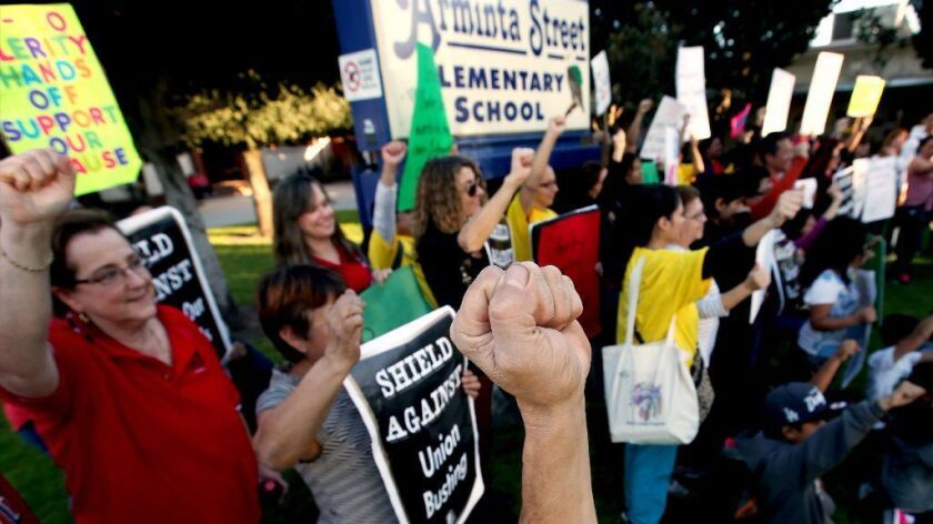 Parents of Arminta Street Elementary School students protest the possible opening of a Celerity charter school inside their school this fall.