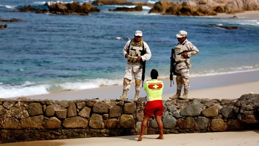 Mexican soldiers in August patrol Palmilla Beach, where three men were killed by a group with automatic weapons in San Jose del Cabo, Baja California Sur.