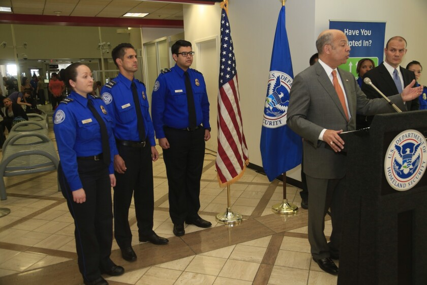 Secretary of Homeland Security Jeh Johnson tours Los Angeles International Airport, where he honored fallen TSA officer Gerardo I. Hernandez, who was killed in a shooting last year in Terminal 3.