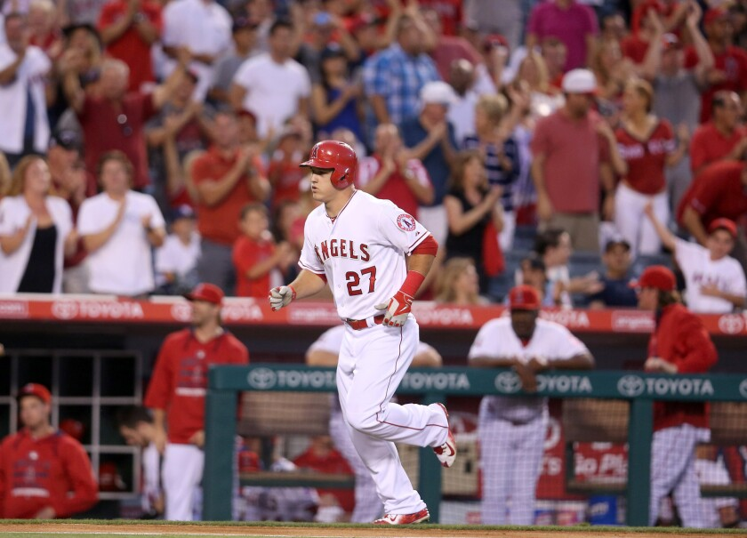 Mike Trout rounds the bases after hitting a solo home run against New York in the third inning of the Angels' 4-1 victory over the Yankees on Monday at Angel Stadium.