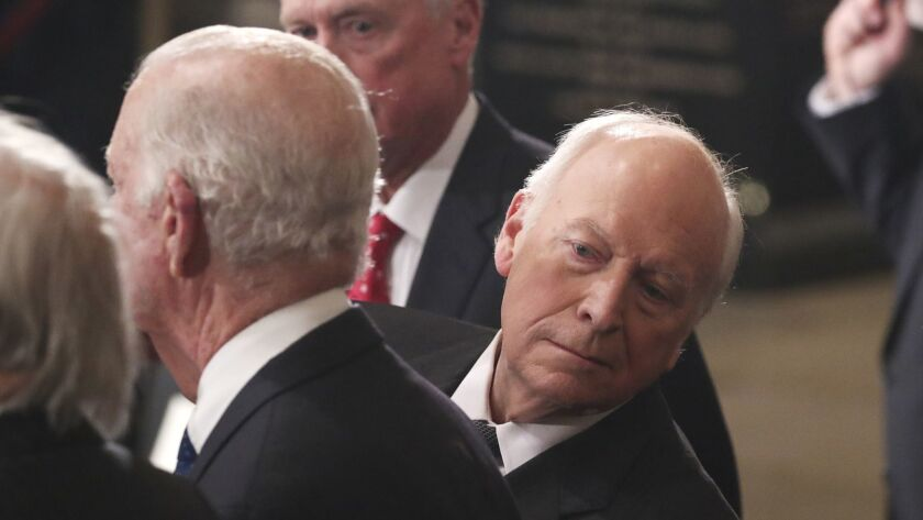 FILE - In this Dec. 3, 2018, file photo, former Vice President Dick Cheney looks behind former Secre