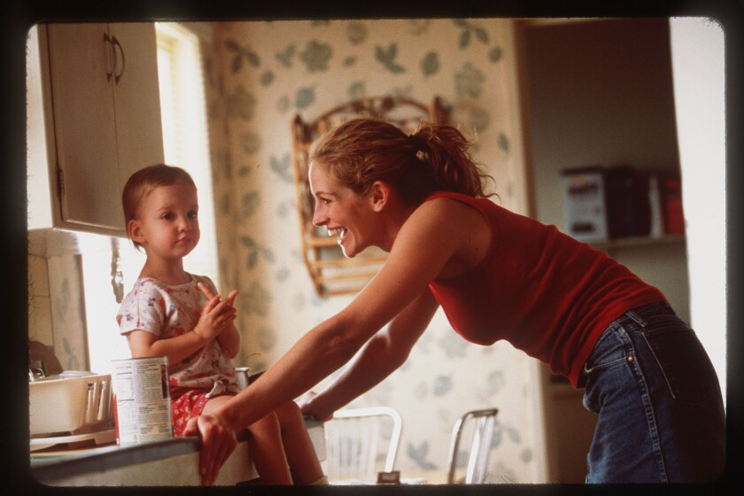 A single mother's job loss could hurt children for years, according to a new study. Pictured here, Julia Roberts, who played the single mom Erin Brockovich.
