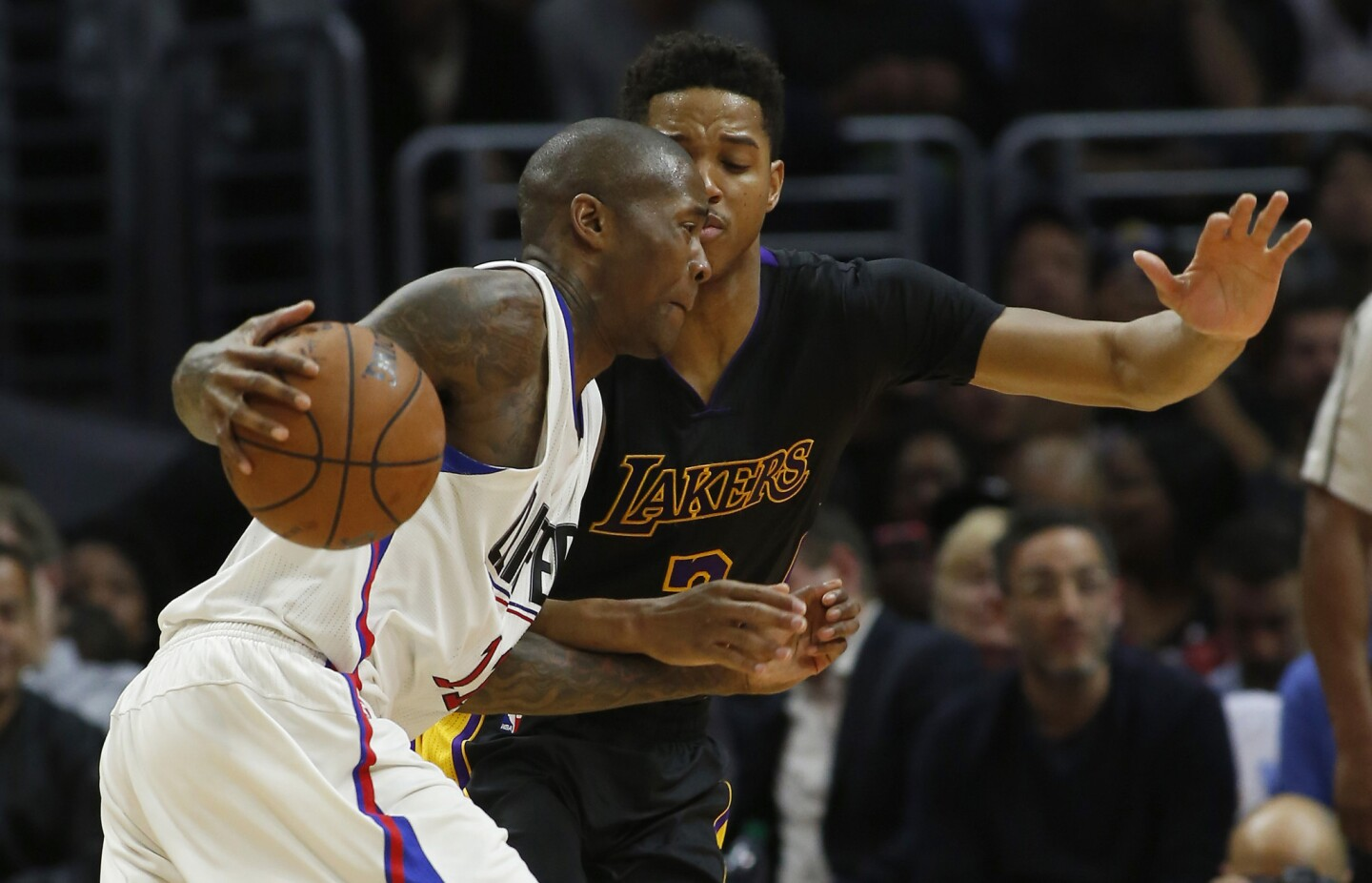 Clippers' Jamal Crawford, left, drives on Lakers' Anthony Brown, right, in fourth quarter on Friday.