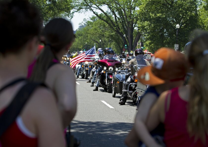 Participants in the Rolling Thunder annual motorcycle rally ride in the national mall during the annual parade ahead of Memorial Day in Washington, Sunday, May 24, 2015. (AP Photo/Jose Luis Magana)