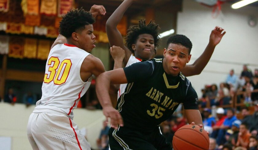 Army-Navy's Richard Polanco looks for an opening as a pair of Los Angeles Fairfax players apply defense. Polanco finished with 10 points.