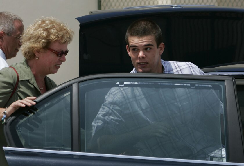 FILE - In this Sept. 3, 2005 file photo, Dutch teen Joran van der Sloot, 18, enters his family's car as his mother Anita closes the door after he was conditionally released from the KAI jail in San Nicolas, Aruba. Van der Sloot, the prime suspect in the 2005 disappearance of U.S. teen Natalee Holloway, married his pregnant Peruvian girlfriend on Friday, July 4, 2014 in a ceremony at the maximum-security prison where he is serving 28 years for murdering a woman he met in a Lima casino. (AP Photo/Leslie Mazoch, File)