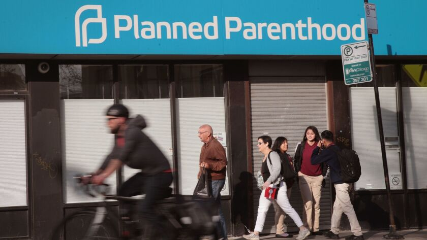 Pedestrians walk past a Planned Parenthood clinic in Chicago on May 18.