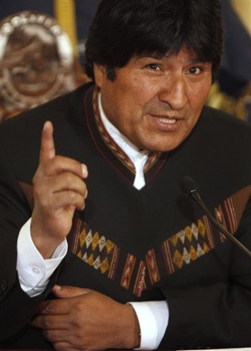 """Bolivia's President Evo Morales speaks during a press conference in La Paz, Wednesday, July 1, 2009. Morales called President Barack Obama """"the new policeman"""", and accused him of lying to Latin America after his administration extended a decision to suspend trade preferences for Bolivia, made six months ago by former President George Bush. (AP Photo/Dado Galdieri)"""