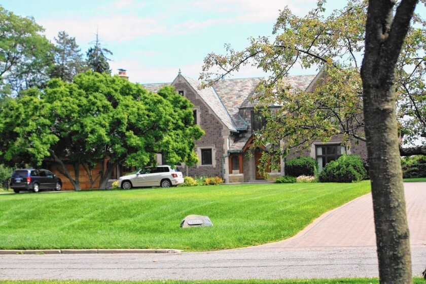 The leafy streets of Grosse Pointe Park, Mich., tend to boast manicured lawns and well-maintained homes.