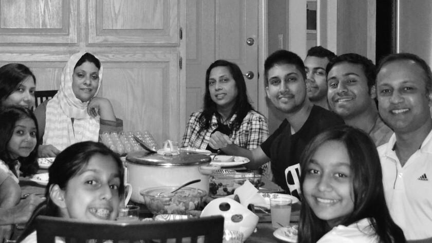 A Bangladeshi American iftar: Reza Islam's family enjoys juice, fried pakoras, fruits, lentil soup and chicken curry.