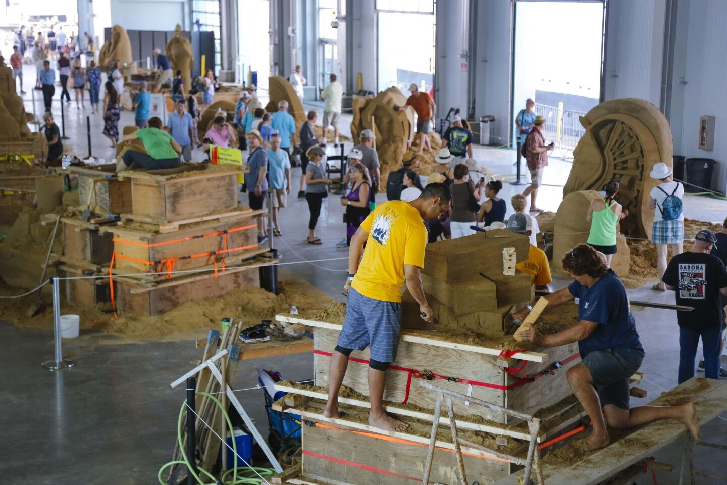 Entrants in the 3 Person Team and World Master Solo divisions are hard at work during preparing their entries during the U.S. San Sculpting Challenge and Dimensional Art Exposition at the Broadway Pier. (Howard Lipin/San Diego Union-Tribune)