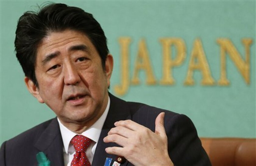 """Japanese Prime Minister Shinzo Abe speaks during a press conference in Tokyo, Friday, April 19, 2013. Abe said reviving Japan's growth will depend on further opening the economy and tapping the underutilized potential of its women and advanced technology. Abe outlined the next steps of his grand plan for restoring Japan's economic power Friday, describing a slew of initiatives he said would help awaken Japan's """"sleeping dynamism."""" (AP Photo/Shizuo Kambayashi)"""