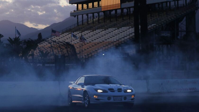 IRWINDALE, CALIF. - APR. 19, 2018. A driver performs donuts while burning rubber in the burnout pa