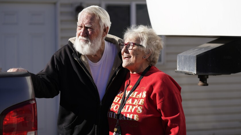 Kathy and Bud Scott pose for a photograph at their home on Dec. 3 in West Valley, Utah.