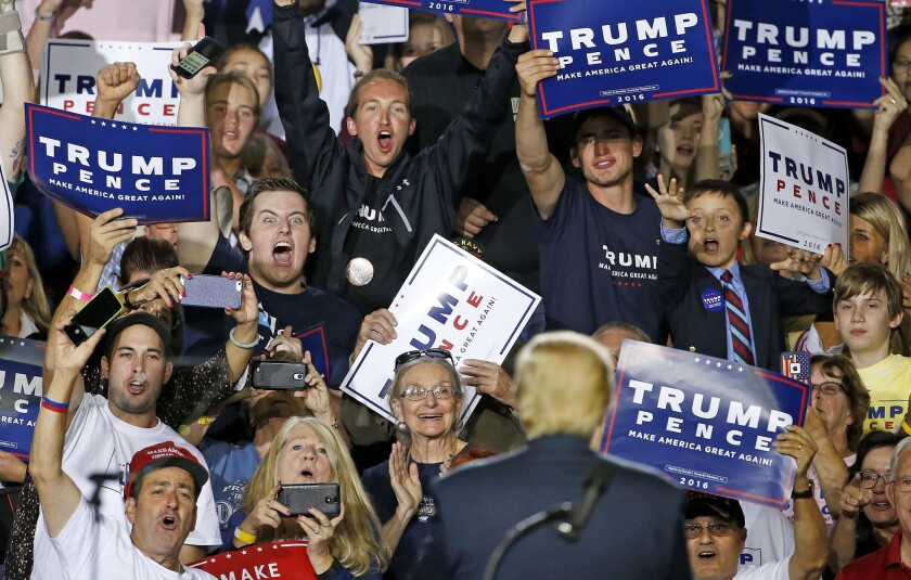 In 2016, supporters cheer Republican presidential candidate Donald Trump at a campaign rally in Prescott Valley, Ariz.