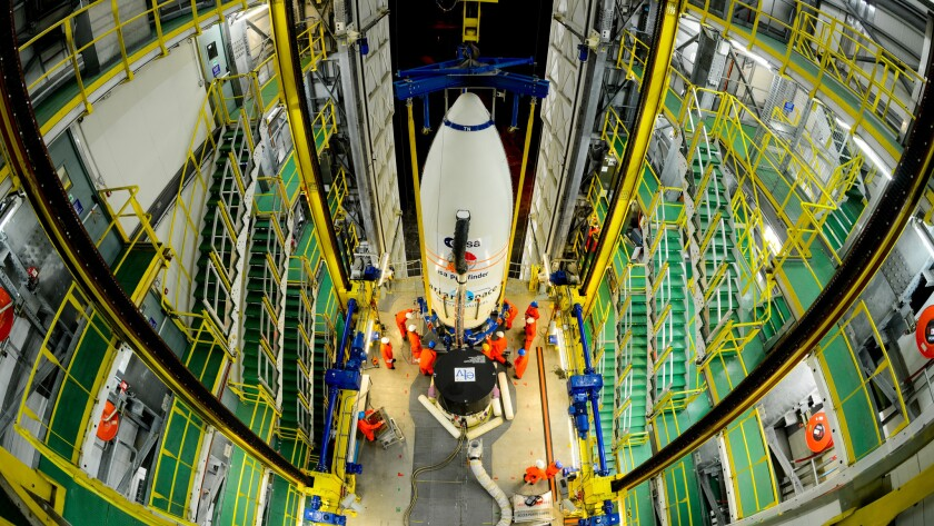 """Workers hoist a module carrying the European Space Agency's LISA Pathfinder craft to the top of a rocket. Scientists in the U.K. are concerned about how """"Brexit"""" will affect their work with the ESA and other European science groups."""