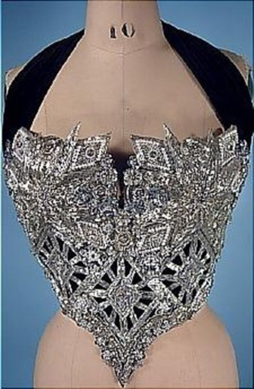 This undated photo provided by Julien's Auctions shows a bustier worn on stage by Whitney Houston which fetched $18,750 at an auction in Beverly Hills of memorabilia from the late pop star's career on Saturday, March 31, 2012, in Beverly Hills, Calif. (AP Photo/Julien's Auctions)