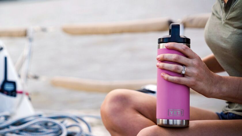 Pink YETI Rambler on a boat. Credit: Dick's Sporting Goods