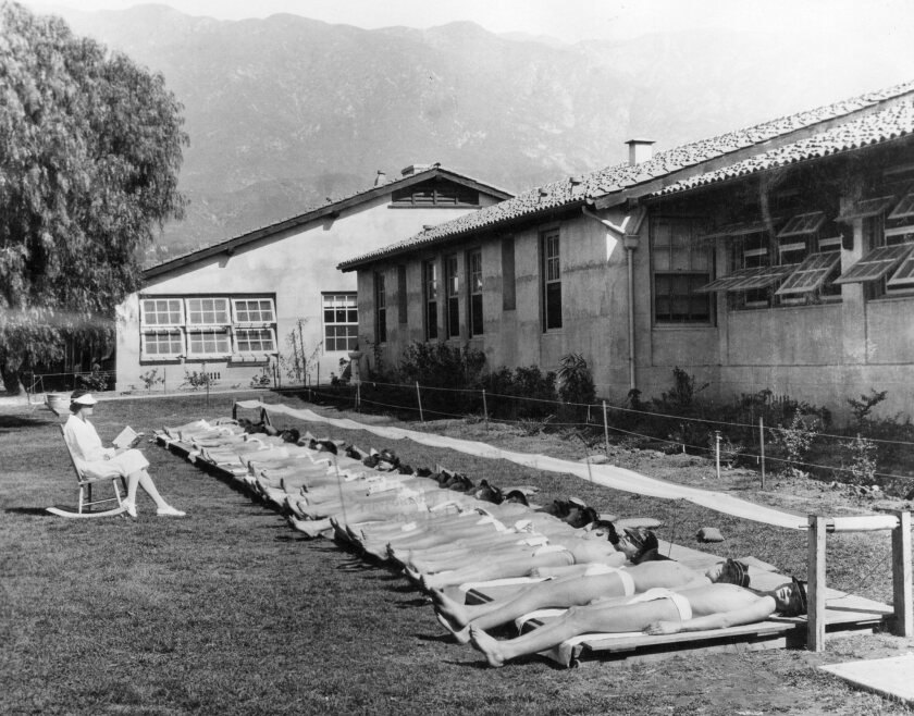 """A photograph featured in """"Sun Seekers: The Cure of California"""" of boys sunbathing circa 1928 at an o"""