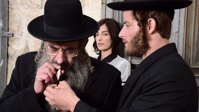 """Doval'e Glickman, Ayelet Zurer, and Michael Aloni in """"Shtisel"""" on Netflix. The show is about the lif"""