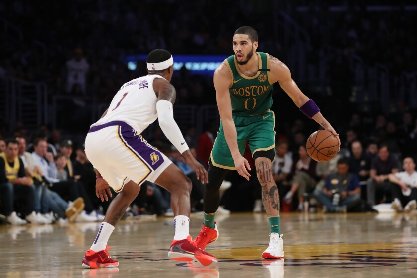 Celtics forward Jayson Tatum sets up the offense while guarded by Lakers guard Kentavious Caldwell-Pope on Feb. 22 at Staples Center.