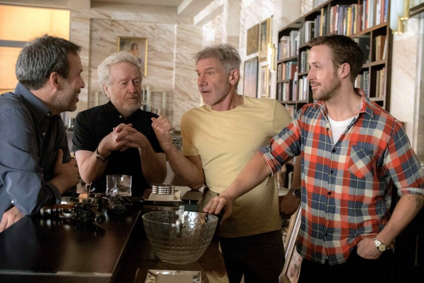 """Denis Villeneuve, from left, Ridley Scott, Harrison Ford and Ryan Gosling on the set of Alcon Entertainment's """"Blade Runner 2049."""""""