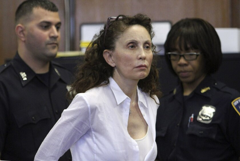 FILE - In this Aug. 11, 2011, file photo, Gigi Jordan, the multimillionaire mother charged with killing her autistic 8-year-old son, appears in Manhattan Supreme court in New York. Jordan testified at her murder trial Thursday, Oct. 9, 2014, that she heard the boy struggling to breathe and her heart pounded. She says she sobbed and tried to resuscitate her son, Jude Mirra. Jude was later found dead of a drug overdose, with Jordan on the floor. (AP Photo/File, Mary Altaffer, File)