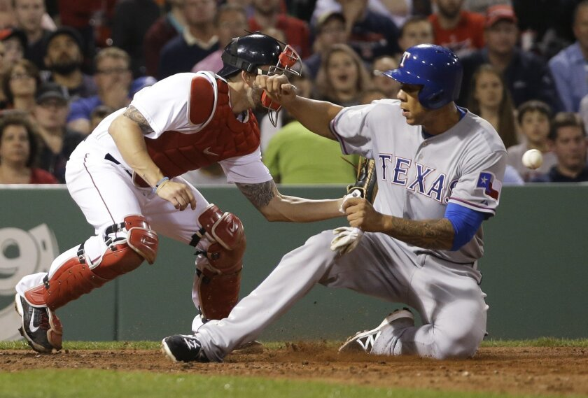 Texas Rangers' Kyle Blanks slides in safely at home on a single by Thomas Field as Boston Red Sox catcher Blake Swihart waits for the ball in the sixth inning of a baseball game at Fenway Park in Boston, Tuesday May 19, 2015. (AP Photo/Elise Amendola)