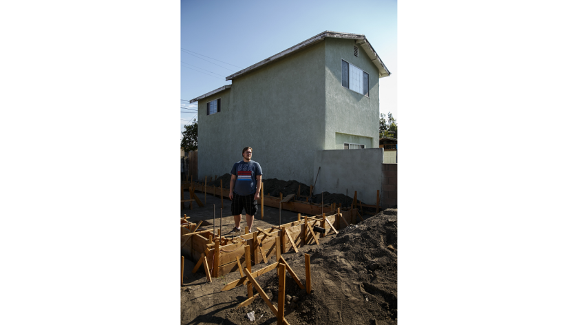 John Gregorchuck stands amid construction of a secondary living unit in his Los Angeles backyard. In Glendale, the City Council approved an interim ordinance to regulate the construction of accessory-dwelling units, also known as granny flats.