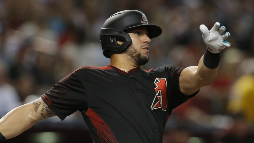FILE - In this Aug. 17, 2019 file photo Arizona Diamondbacks' David Peralta hits against the San Francisco Giants in the first inning of a baseball game in Phoenix. The Diamondbacks have finalized a $22 million, three-year contract with Peralta that runs through 2022, Monday, Jan. 13, 2020. (AP Photo/Rick Scuteri, file)