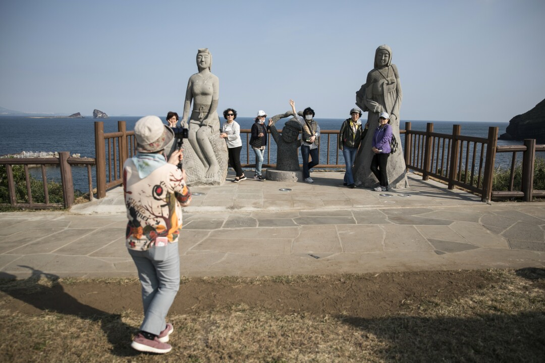 A visitor snaps photos on Jeju Island.