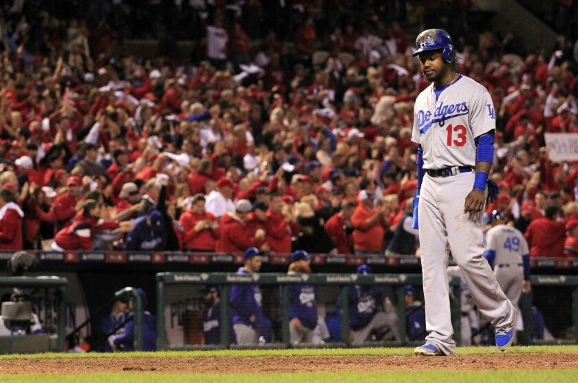 Los Angeles Dodgers shortstop Hanley Ramirez walks off the field at the end of Game 3 of baseball's NL Division Series against the St. Louis Cardinals, Monday, Oct. 6, 2014, in St. Louis. The Cardinals won 3-1. (AP Photo/Jeff Roberson)