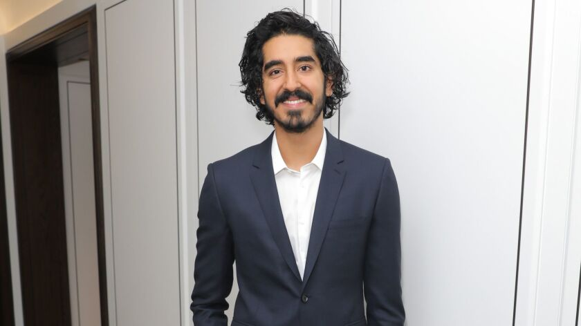 "Dev Patel wears Burberry to a party the luxury British fashion brand and the Weinstein Co. had to celebrate Patel's new film, ""Lion."""