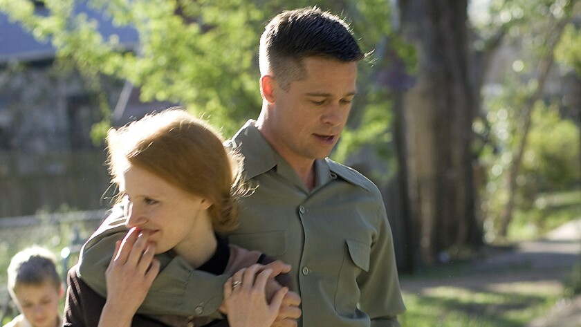 Jessica Chastain and Brad Pitt in the movie The Tree of Life. PHOTO CREDITS: MERIE WALLACE TM & (c)