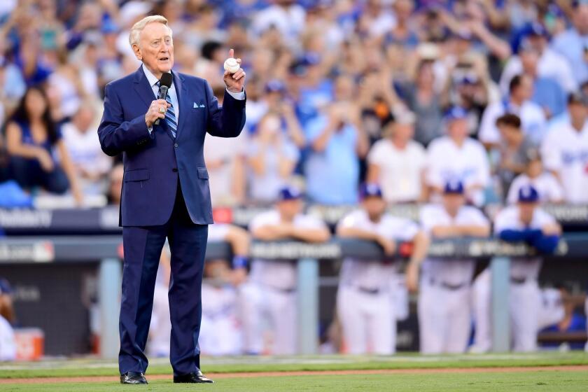Former Dodgers broadcaster Vin Scully speaks during a pregame ceremony at Dodger Stadium.