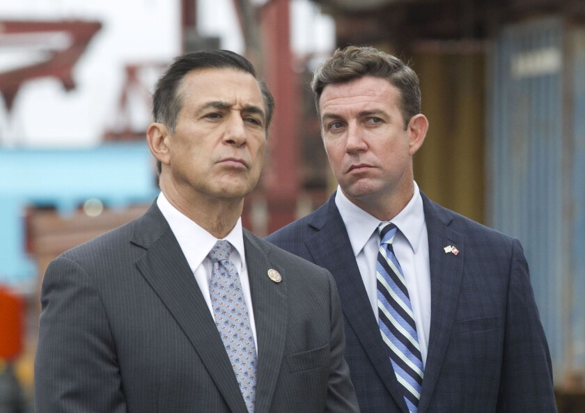 Former Rep. Darrell Issa, left, thinks President Trump should consider reducing the sentence of convicted Rep. Duncan Hunter, right.