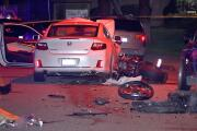 Motorcycle rider killed in collision with sedan