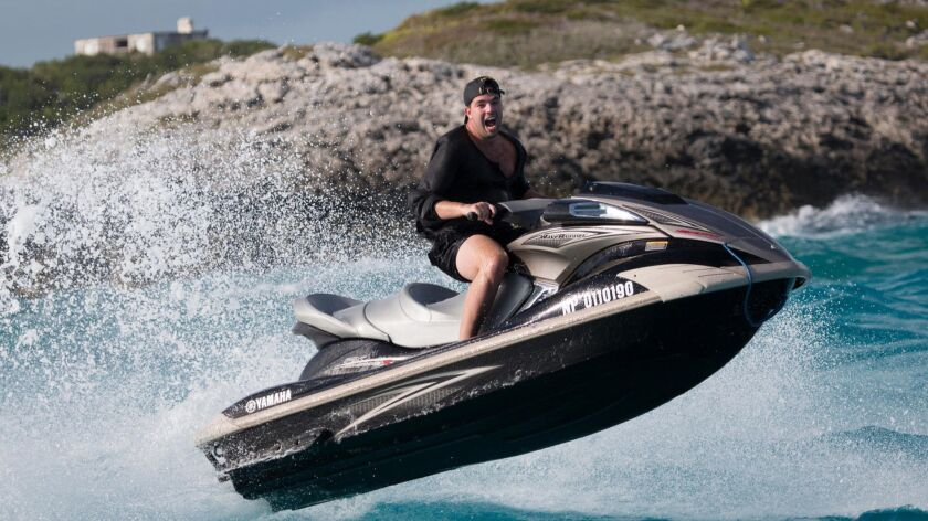 Billy McFarland, seen here on a jetski in the Bahamas, promoted his Fyre Fest as a luxury music festival on a private island featuring bikini-clad supermodels.