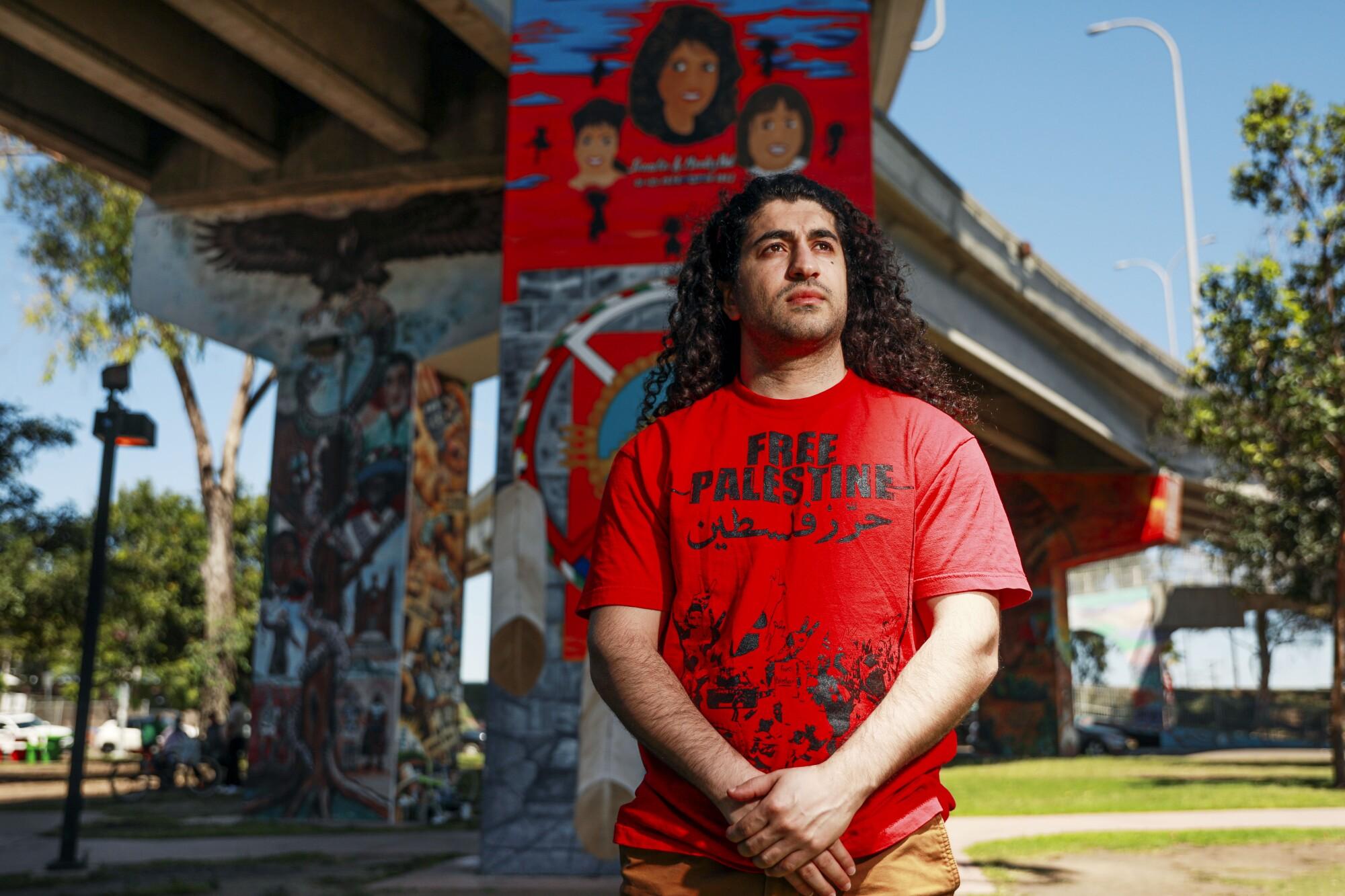 Ali-Reza Torabi stands in San Diego's Chicano Park