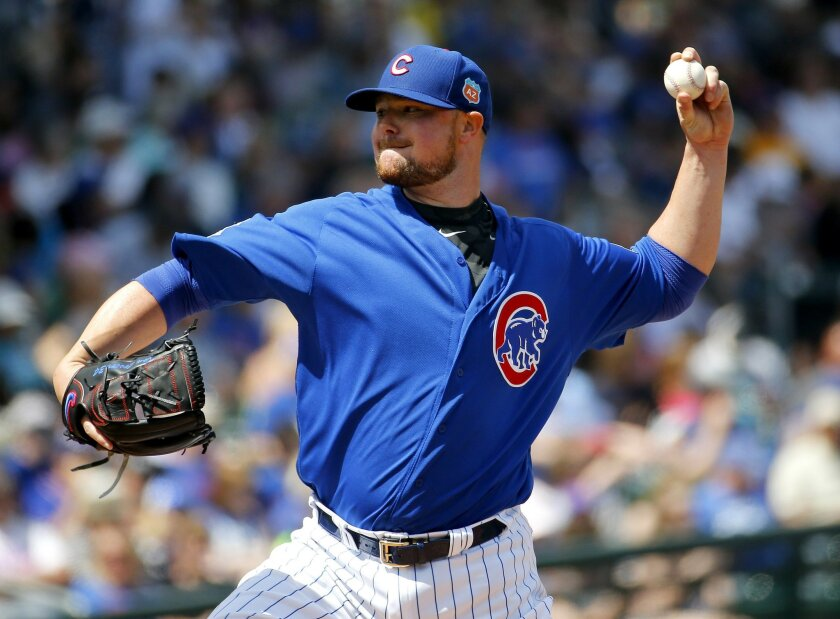 Chicago Cubs pitcher Jon Lester throws during the second inning of a spring training baseball game against the Colorado Rockies, Wednesday, March 30, 2016, in Mesa, Ariz. (AP Photo/Matt York)