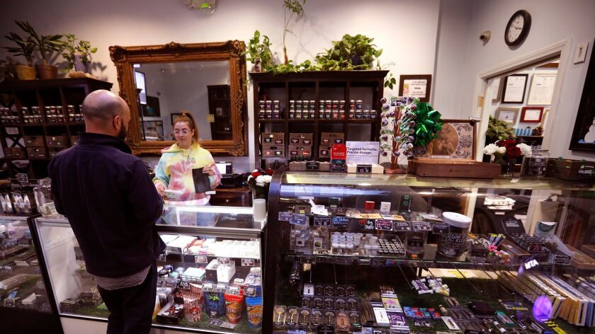 SHERMAN OAKS, CA - DECEMBER 28, 2017 -- Budtender Erin Clowry fills an order for a customer at The H