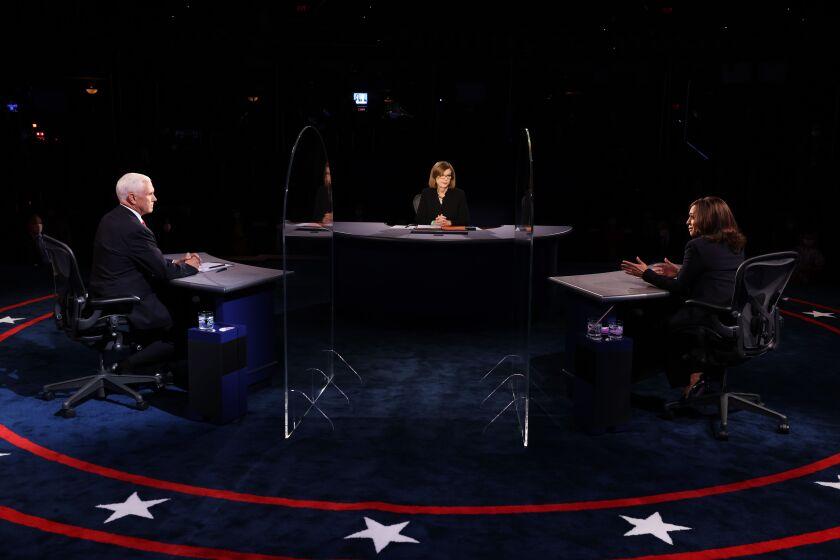 Vice President Mike Penc, Sen. Kamala Harris and moderator Susan Page at the debate.
