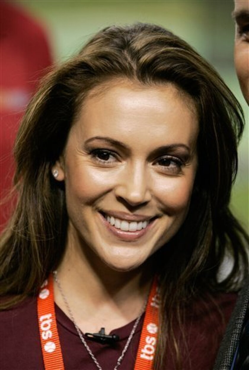 In this Thursday, Oct. 11, 2007 file photo, actress Alyssa Milano is pictured in Phoenix. Milano has asked for a court's protection from a man she says hiked miles to try to her reach her home and has repeatedly tried to meet her. (AP Photo/Ross D. Franklin)