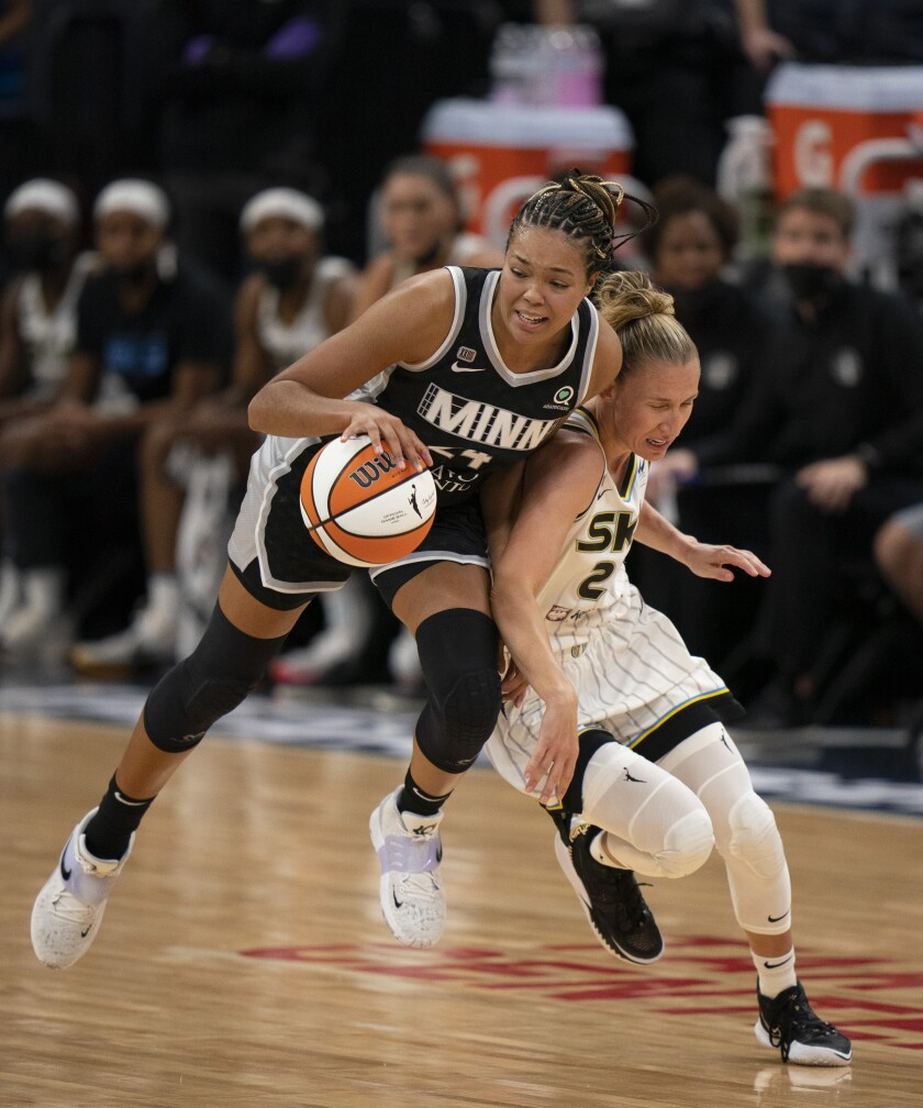 Minnesota Lynx forward Napheesa Collier (24) gets control of the ball after forcing Chicago Sky guard Courtney Vandersloot (22) to turn it over in the second quarter of a WNBA basketball game, Sunday, Sept. 26, 2021, in Minneapolis. (Jeff Wheeler/Star Tribune via AP)