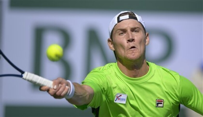 Matthew Ebden, of Australia, returns a shot to Frank Dancevic, of Canada, during their match at the BNP Paribas Open tennis tournament on Wednesday, March 6, 2013, in Indian Wells, Calif. (AP Photo/Mark J. Terrill)