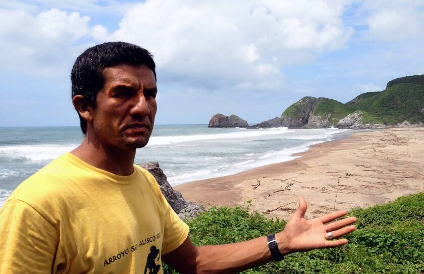 Artemio Rosas, a surf shop owner and real estate broker in Arroyo Seco, Mexico, thinks letting foreigners buy coastal land would help his business and create good jobs. Many other people oppose the idea.