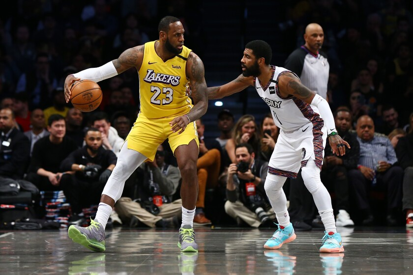 Nets guard Kyrie Irving defends against Lakers forward LeBron James during the first half of a game Jan. 23, 2020, at Barclays Center.