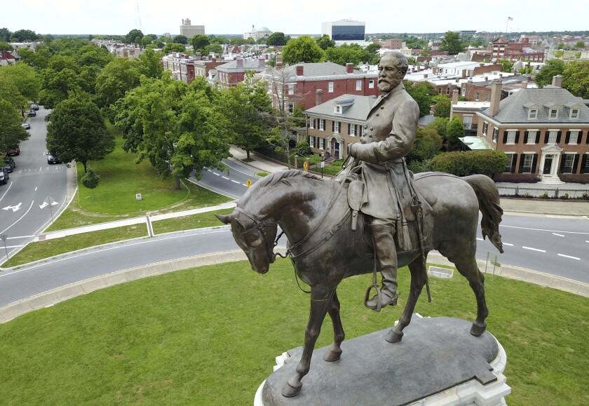 EDS NOTE: OBSCENITY - FILE - This Tuesday, June 27, 2017, file photo shows a statue of Confederate General Robert E. Lee in the middle of a traffic circle on Monument Avenue in Richmond, Va. Just a little over a month ago, the area around Richmond's iconic statue of Confederate Gen. Robert E. Lee was as quiet and sedate as the statue itself. But since the May 25, 2020, police killing of George Floyd in Minneapolis, the area has been transformed into a bustling hub of activity for demonstrators protesting against police brutality and racism. (AP Photo/Steve Helber, File)