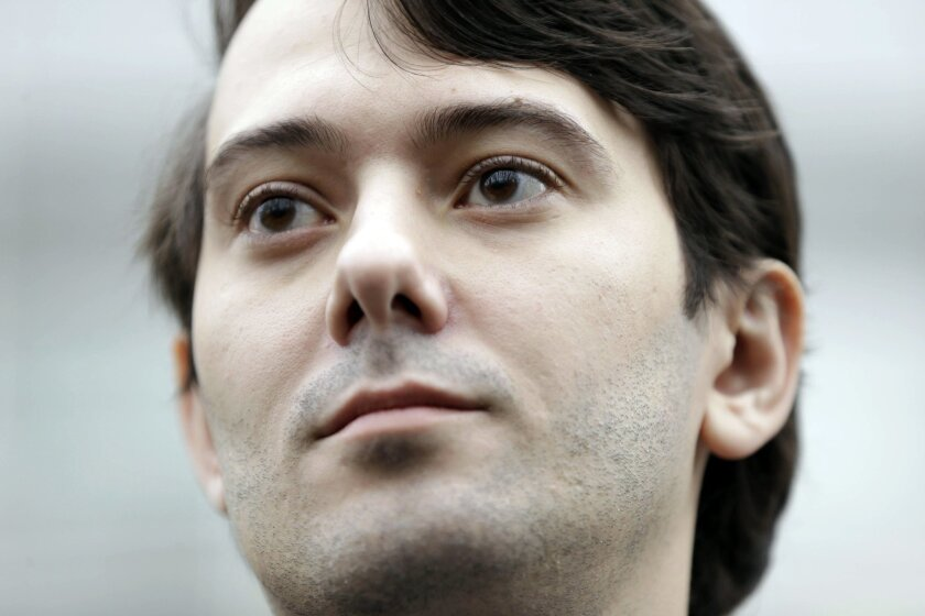 FILE - In this Wednesday, Feb. 3, 2016, file photo, former Turing Pharmaceuticals CEO Martin Shkreli leaves court in New York. Federal prosecutors in New York have filed additional criminal charges against THE pharmaceutical executive who separately was heavily criticized for raising the price of a