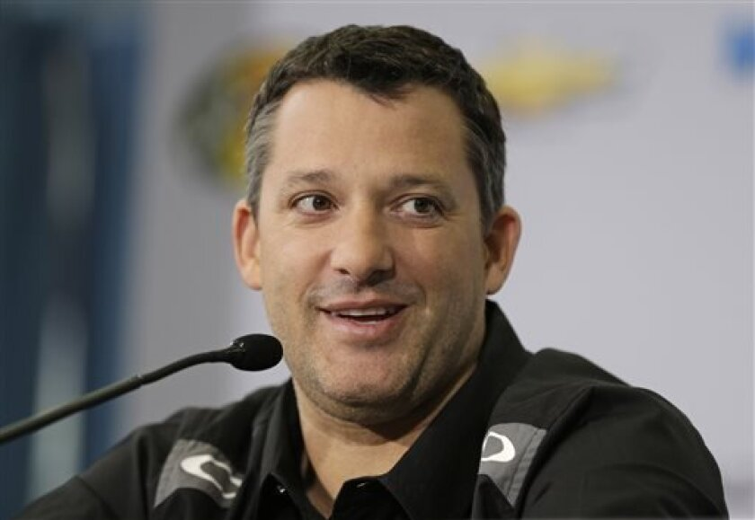 NASCAR driver and team co-owner Tony Stewart speaks to the media during a news conference at Stewart-Haas Racing's headquarters in Kannapolis, N.C., Tuesday, Sept. 3, 2013. (AP Photo/Chuck Burton)